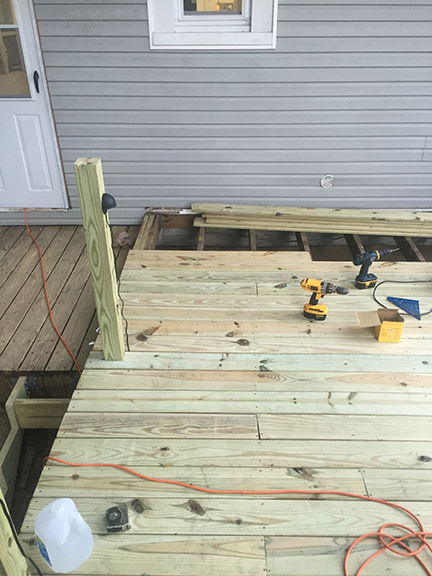 above-view-of-new-deck-boards-with-rail-posts