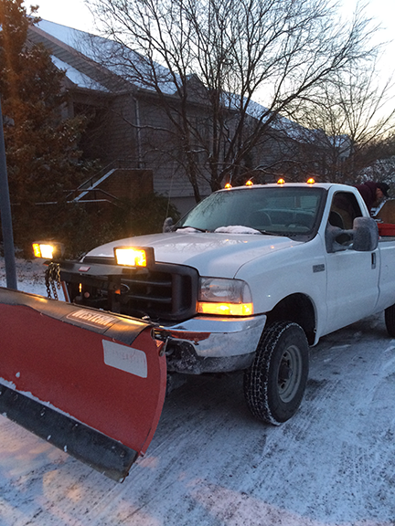 truck-with-snow-plow-to-clear-streets